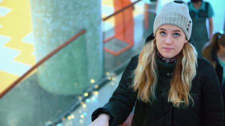 lágyság : Young attractive girl riding an escalator in the mall. Up Stock mozgókép