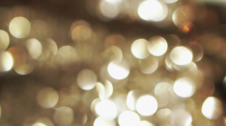 doted : Abstract glittering gold lights, a real shot video in the blur Stock Footage
