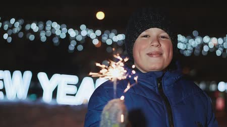 bengália : The boy on the street, New Years Eve. He holds a sparkler and waves it. Stock mozgókép