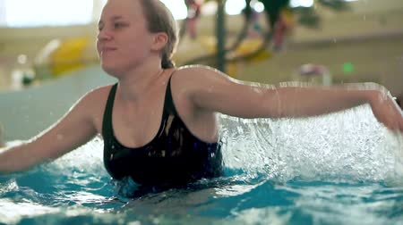 aqua park : Teenager girl in water in public indoor aqua park pool.