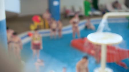 desfocado : Unfocused view. Children and parents have fun in the childrens water park.