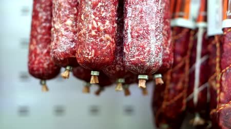 вылеченный : Smoked, dried sausages hanging at butcher meat market