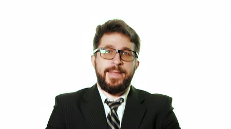 dobras : Bearded businessman wearing glasses and a suit on a white background. He is a winner, satisfied and folds his hands in front of him, slow motion