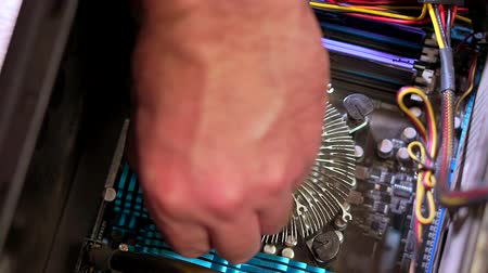 chipset : Close-up of the hand of the service man uninstall the radiator of the CPU. Personal computer repair Stock Footage