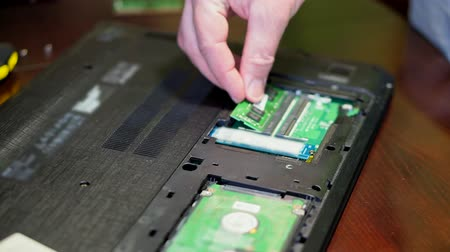 yedek : Man installing memory. Laptop RAM upgrade