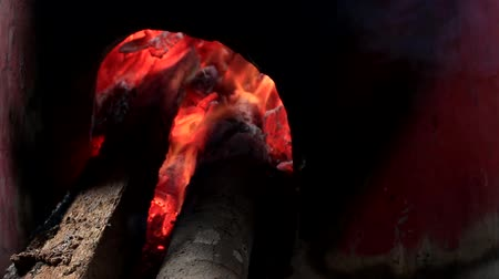 charcoal stove : close up of burning wood and red hot charcoal in a traditional stove