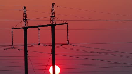 marco nacional : Power station at sunset. Electrical wires on the background of evening sky. Industry.