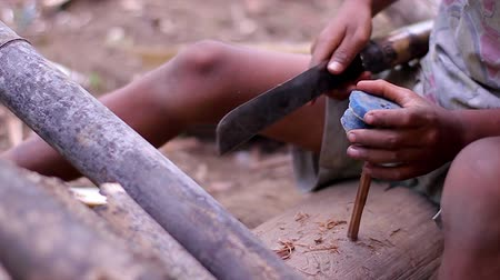 bída : Boy do handicraft  in the yard. Rural boy making toy. Provincial poverty.