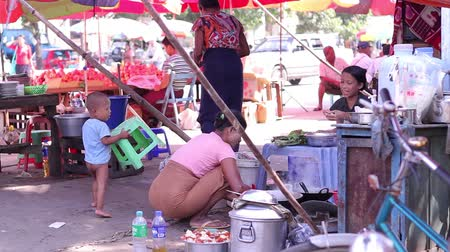 sujo : Myanmar, Yangon. 23.11.2013  Asian market. Homeless people. Gypsy camp. Daily lives of people in poor countries.
