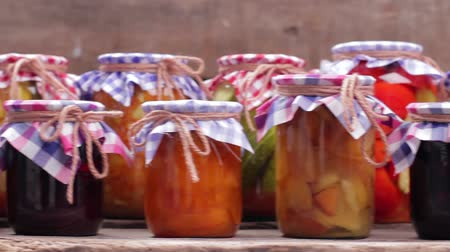 przetwory : Organic food. Home canned in glass jars. Preservation  on the old boards. Wideo
