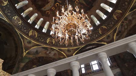 murals : Huge dome of the Orthodox church. Icons on the dome of the ancient cathedral. Paintings on the walls of the church. Painting the interior in an old church. Christian church. Stock Footage