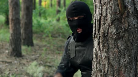 hostility : Police are preparing to arrest the perpetrator. Bandits are preparing an attempt. Ambush of criminals in the forest. Terrorists preparing a terrorist attack.