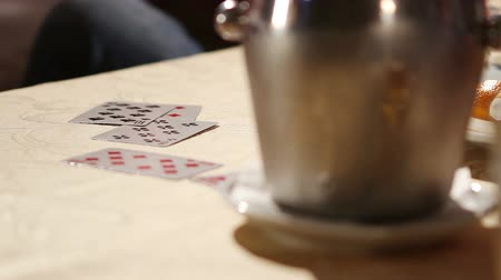 yarışma : Men playing cards. Gambling. Cards on the table of the restaurant. Groups of friends playing cards. Stok Video