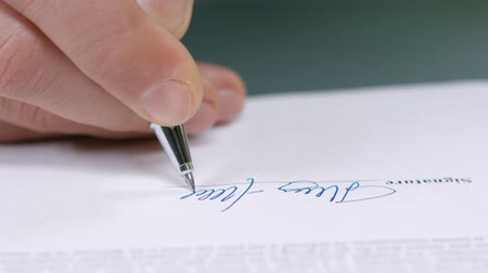 anlaşma : Businessman signs a document. Business deal. Signing of the contract. Signing of agreements.