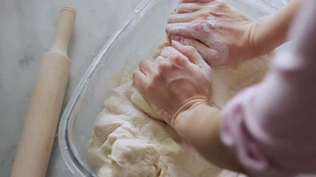 pekař : Baker prepares the dough.