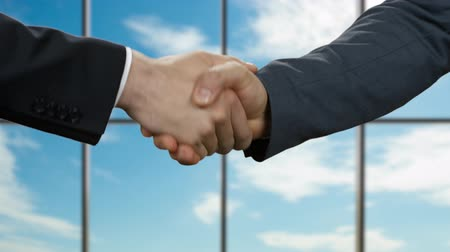 promover : Businessmen shake hands in office.