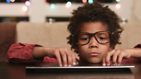 darkskinned : Kid at keyboard expressing happiness. Stock Footage