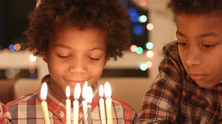 darkskinned : Black children with birthday cake.