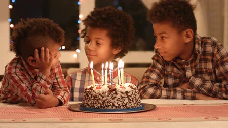 darkskinned : Afro boys and birthday cake.