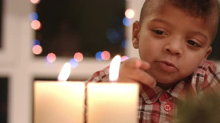 darkskinned : Upset child looking at candle. Stock Footage