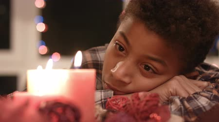 darkskinned : Sad boy looking at candle. Stock Footage