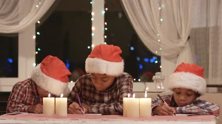 darkskinned : Little Santas writes a letter. Stock Footage
