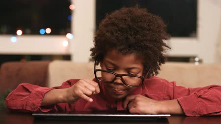 darkskinned : Black boy typing on keyboard.