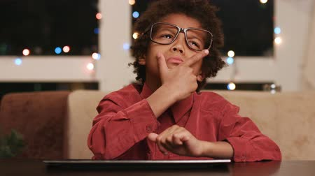 darkskinned : Frustrated kid sitting at keyboard. Stock Footage