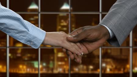 darkskinned : Black businessman shaking female hand. Handshake of businesspeople at midnight. This city needs new government. Building ways towards success. Stock Footage