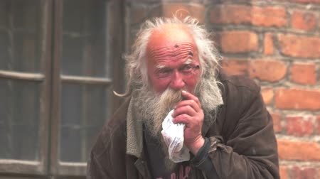 hobo : Vilnius, Lithuania - 12.06.2016. Homeless man in the street. Old guy in dirty clothes. Forgotten and abandoned. Person in need of help.