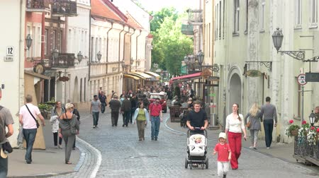europe population : Vilnius, Lithuania - 12.06.2016. People in the street. Man with baby carriage. Take a trip to Vilnius.