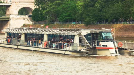 multa : Paris, France - 14.06.2016. Boat with passengers. Embankment of river. Getting lots of new impressions. Tourists enjoy the picturesque view. Vídeos