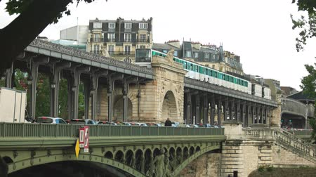 bir hakeim : Paris, France - 14.06.2016. Cars and city train. Bir Hakeim bridge at daytime. Architecture of Paris.