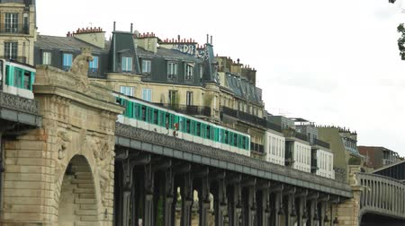bir hakeim bridge : Paris, France - 14.06.2016. City train moves near building. Bir Hakeim bridge. Tourist sight in Paris. Stock Footage