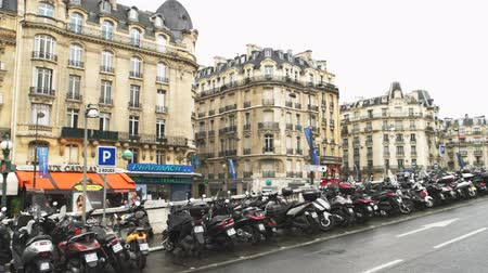 exterior : Paris, France - 14.06.2016. People and transport near building. Restaurant in Paris center. Stop for a lunch.