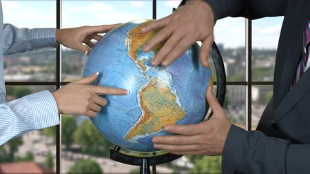 bizonyítani : Woman and man with globe. Hands of business people. World isnt ready for changes. Plans of global scale.