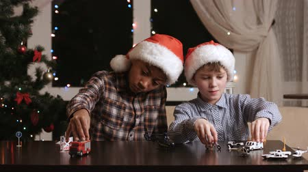 toco : Kids with toy cars. Two boys in Christmas hats. Best holiday presents. Santa knew what I wanted.