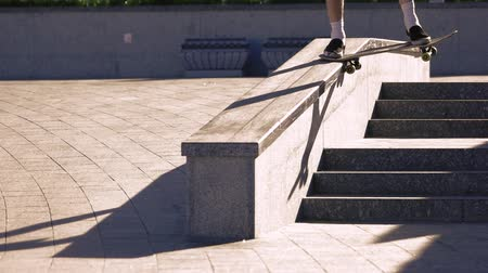 boldness : Skateboarder grinding in slow motion. Person on skateboard. Successful execution of a trick. Control every move. Stock Footage