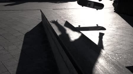 boldness : Legs on skateboard doing trick. Shadow of skateboarder. The perfect kickflip. Skills are progressing. Stock Footage