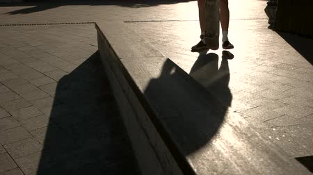 boldness : Feet standing on skateboard. Shadow of a skateboarder. Feeling of balance. I choose sports. Stock Footage