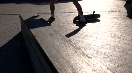 boldness : Skateboarder fails a stunt. Feet and skateboard. Try one more time. Stubbornness of the youth.