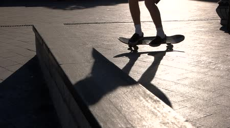 boldness : Skateboarder does stunt in slow-mo. Feet standing on a skateboard. Pop shove it 360 tutorial. Let it spin.