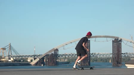 boldness : Guy riding skateboard. Skateboarder on bridge background. Best place for skateboarding. Modern youth chooses sport.