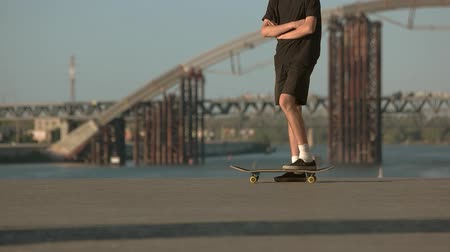 boldness : Skateboarder with crossed arms. Person with skateboard outdoor. Live by your own rules. Young and stubborn.