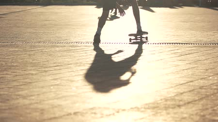 boldness : Skateboard moving in slow motion. Shadow of a skateboarder. Bold and energetic. Practice and mastery. Stock Footage
