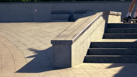 boldness : Skater doing grind trick. Person on skateboard near stairs. Sport and risk. Perfection of movements.