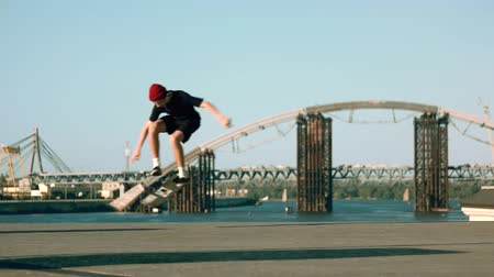 boldness : Skater performs a trick. Guy on skateboard outdoor. My sport is my passion. Against the grain.