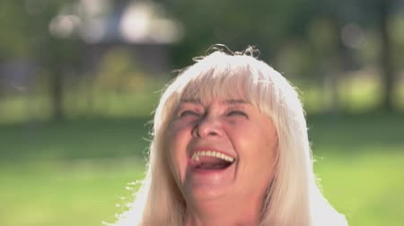 greatest : Face of elderly woman laughing. Happy lady outdoor. Greatest joy in life. All troubles left behind. Stock Footage