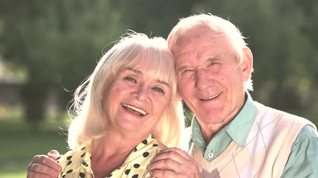 greatest : Couple of seniors outdoor. Man and woman are smiling. Find the greatest happiness. Live and love each other.
