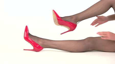elevação : Hands putting on heel shoe. Legs in heels and fishnets. Look chic and stylish. Sale of designer footwear. Vídeos